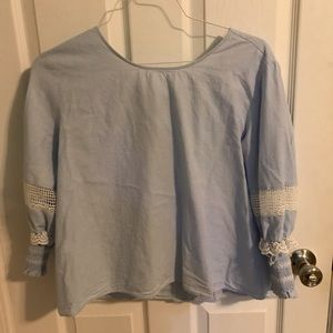 Light blue top with lace detailing and bow on back